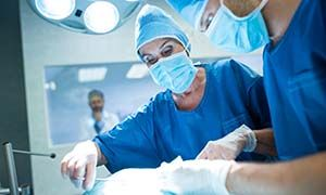 Surgeons performing operation in operation room at the hospital